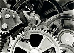 Tempi Moderni. Chaplin era serio, il piduista capo del governo no